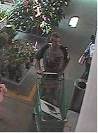 suspect exits gardening still with computer in trolley 1220pm
